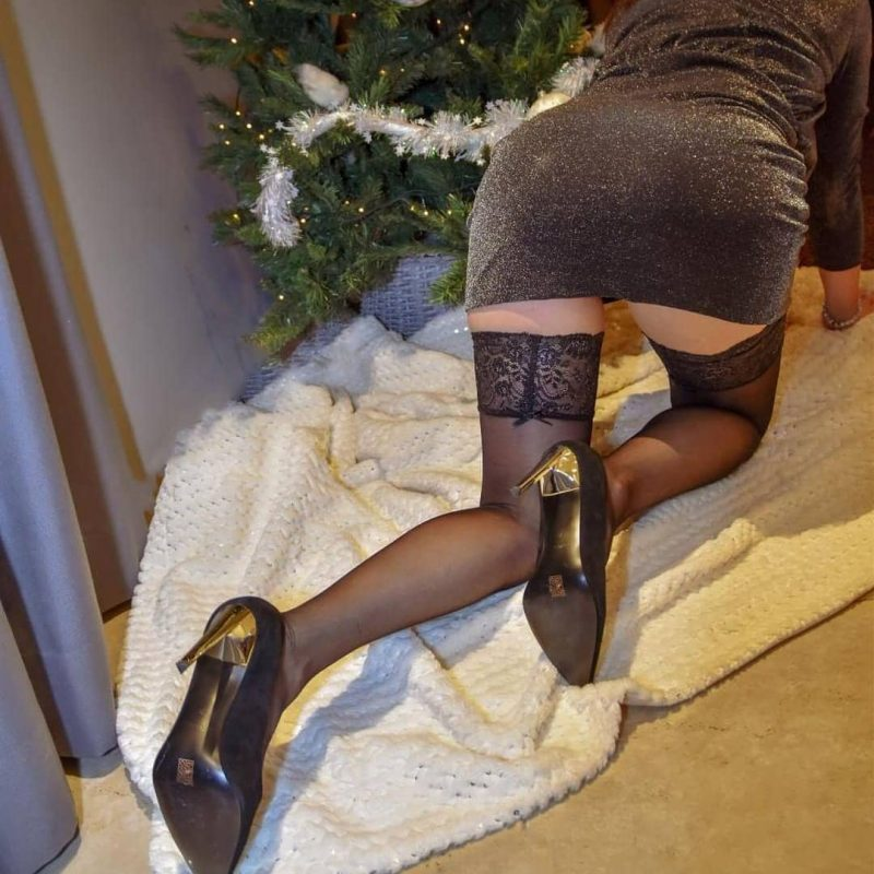 @highheels7027v2.0 in black stockings under the Christmas Tree
